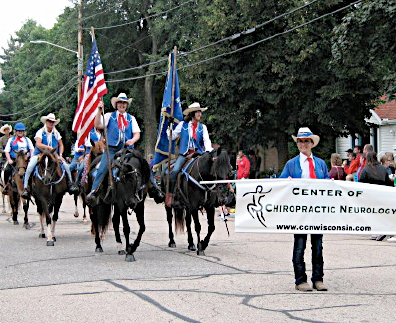 Club members participate in the Cow Chip Parade