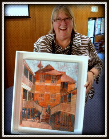 "New Farm School Principal Virginia O'Neill with retirement painting ""Sunny Days"""