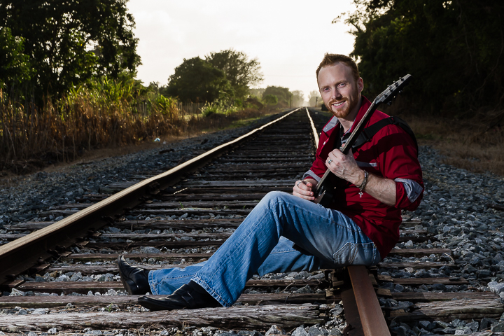 Richard Freeman Playing Guitar On Railroad Tracks