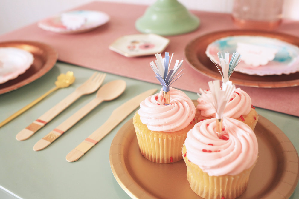 We used mylar tape to spruce our bamboo utensils, and used the same tape to secure our tassels on the end of toothpicks. The tassles make the perfect cupcake toppers!