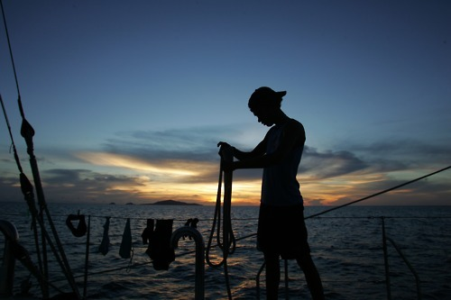 #photooftheday Sunrise from Pelican1. Matt- one of the Aboriginal trainee divers getting ready for a day on the Coral Bleaching project in the Great Barrier Reef. 2006. Photo by Sandy Scheltema
