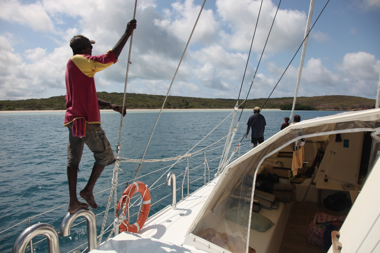 From a distance, Gore Island which is part of the Wuthathi Sea Country, looks like a perfect tropical idyll… Traditional Owner Douglas from Lockhart looks on as we navigate the coral reef to anchor. #Cape York #marinedebris