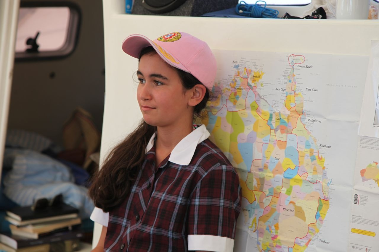 School girl from Manor Lakes on board Pelican1 during Two Bays 2014- learning about Sea Country- behind her is a map of Aboriginal Australia.