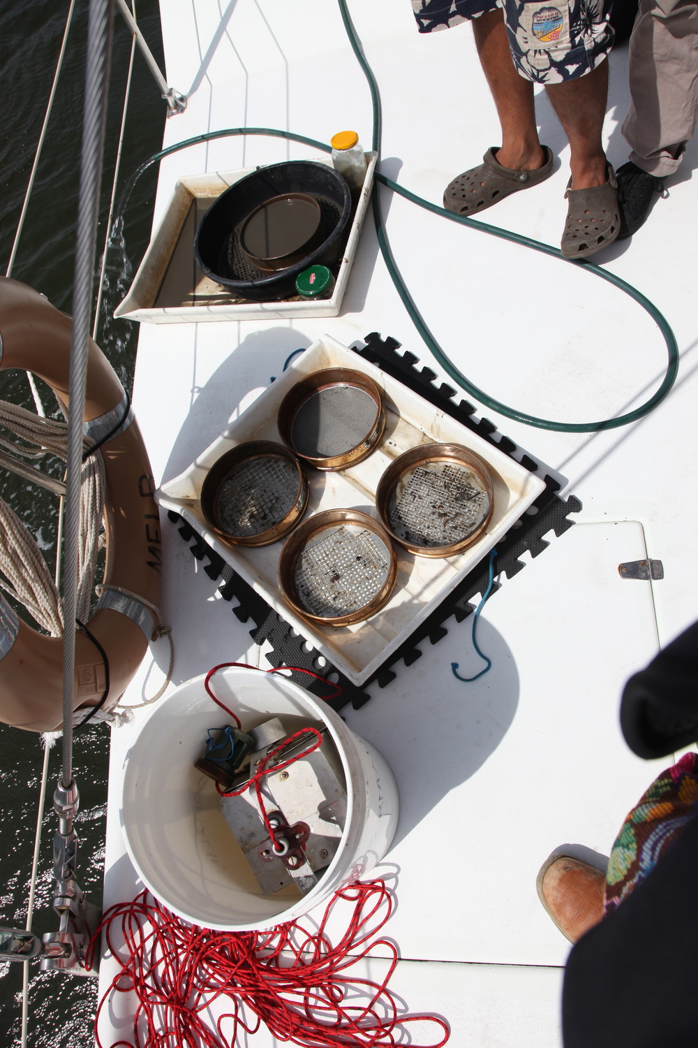 Science on board Pelican1. Here you can see the sediment sampler and the different sized sieves used to find microplastics.