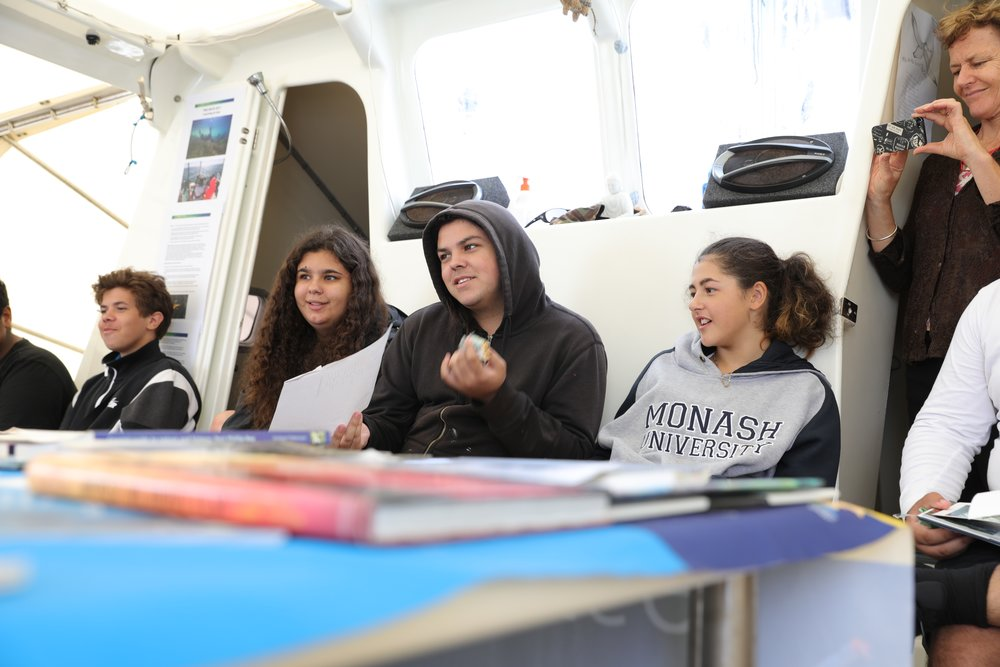 Young people on board learning Boon Wurrung vocabulary with Marbee Williams.