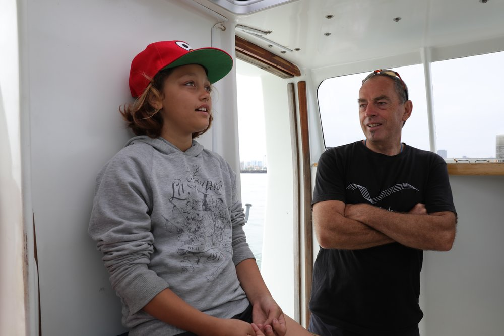 "The Captain teaching the youngest on board about Pelican1's auto pilot after he was asked- ""Who's driving the boat?"""