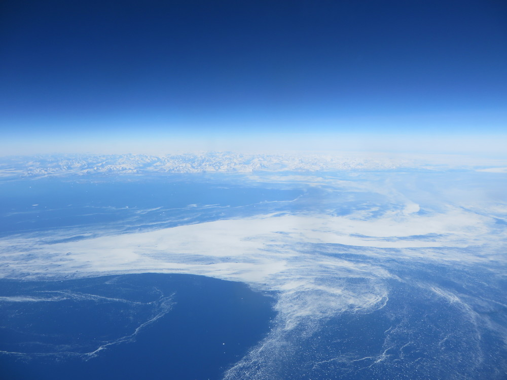 Flying over Greenland on the way home. The white stuff is sea ice.