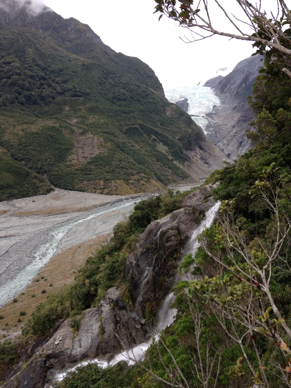 By the waterfall on the Franz Joseph side mission, looking at the glacier.