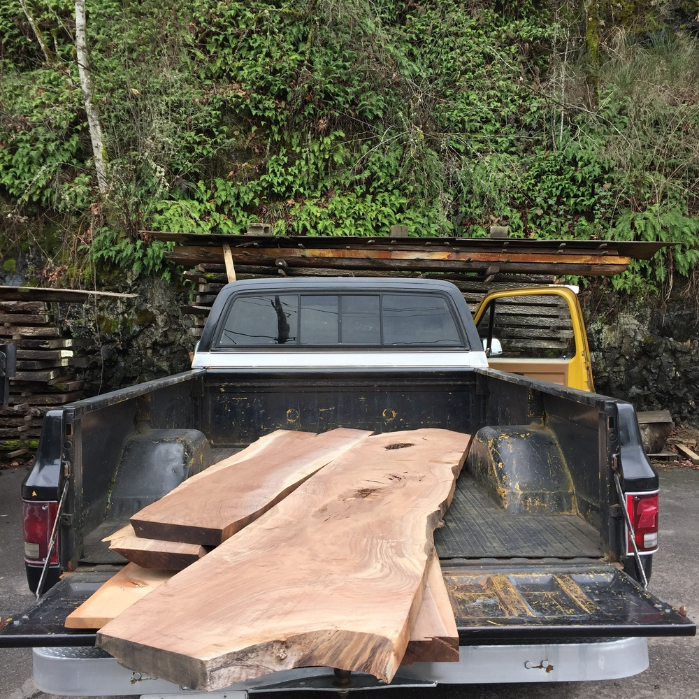 The company truck, affectionately called Bruiser, loaded up with large slabs of claro walnut from Goby.