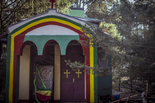 A very old church hidden away in a forest of eucalyptus, over 10,000 feet in elevation, on Mount Entoto. This church draws many people with illnesses seeking the healing powers of the spring the church was built above.