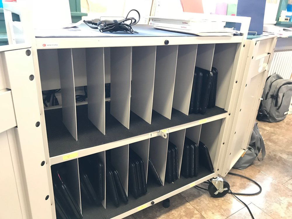 This one cart has 16 slots (for those 16 plugs in the back), but even if you crammed three chrome books to a slot, and somehow macgyvered the charging adapters to charge those crammed chrome books you'd still only be charging 48 of the 64 total chrome books!