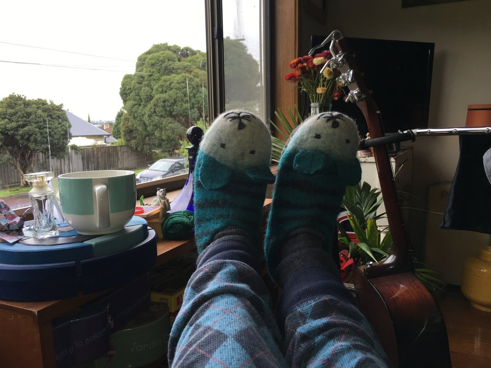 I spent a LOT of time gazing out the window thinking about my life in my pajamas. At least I had cool mouse slippers. Mindfulness practice started here.
