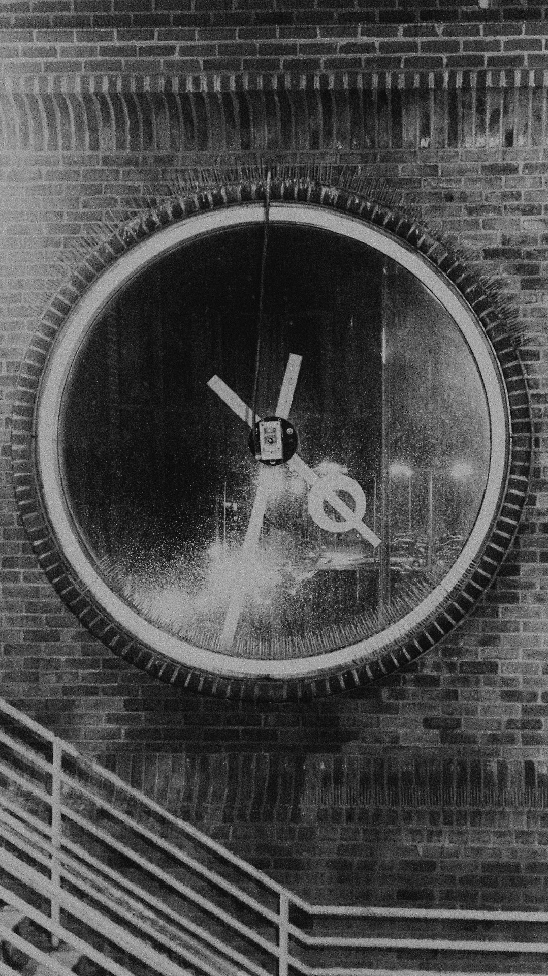 This is a clock at the Ronkonoma LIRR Station.   I love the way the clock acts as a window.   I thought a retro black and white treatment fit the mood this cold, rainy night.  #photography #blackandwhite #railroad