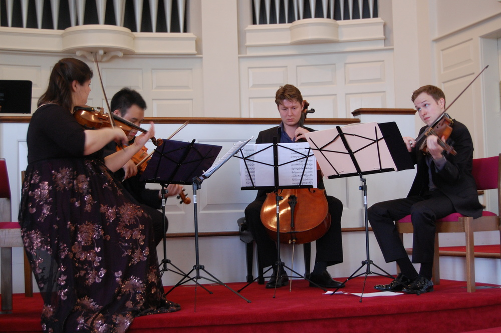 Elizabeth Fayette, Eric Wong, Dmitry Volkov, and Fitz Gary performing at the 2014 Music Feeds Us concert.