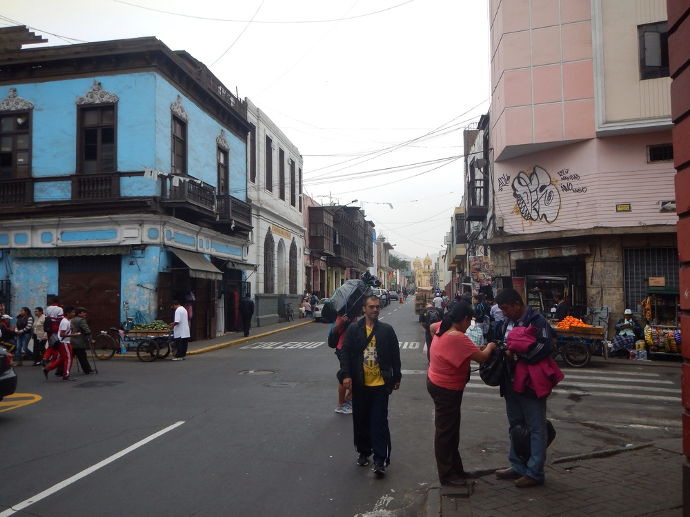 A side street in Lima coming out of the historic city center into  a more run down neighborhood.