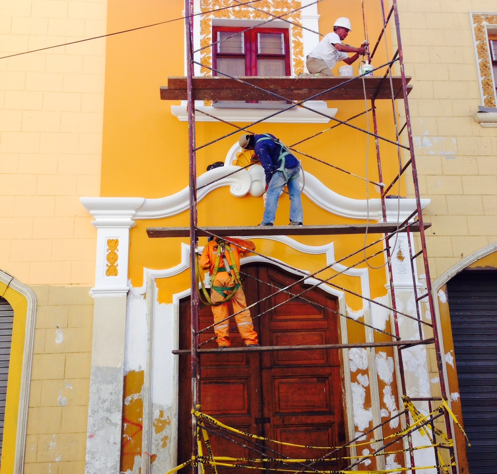 Repainting a building in Arequipa