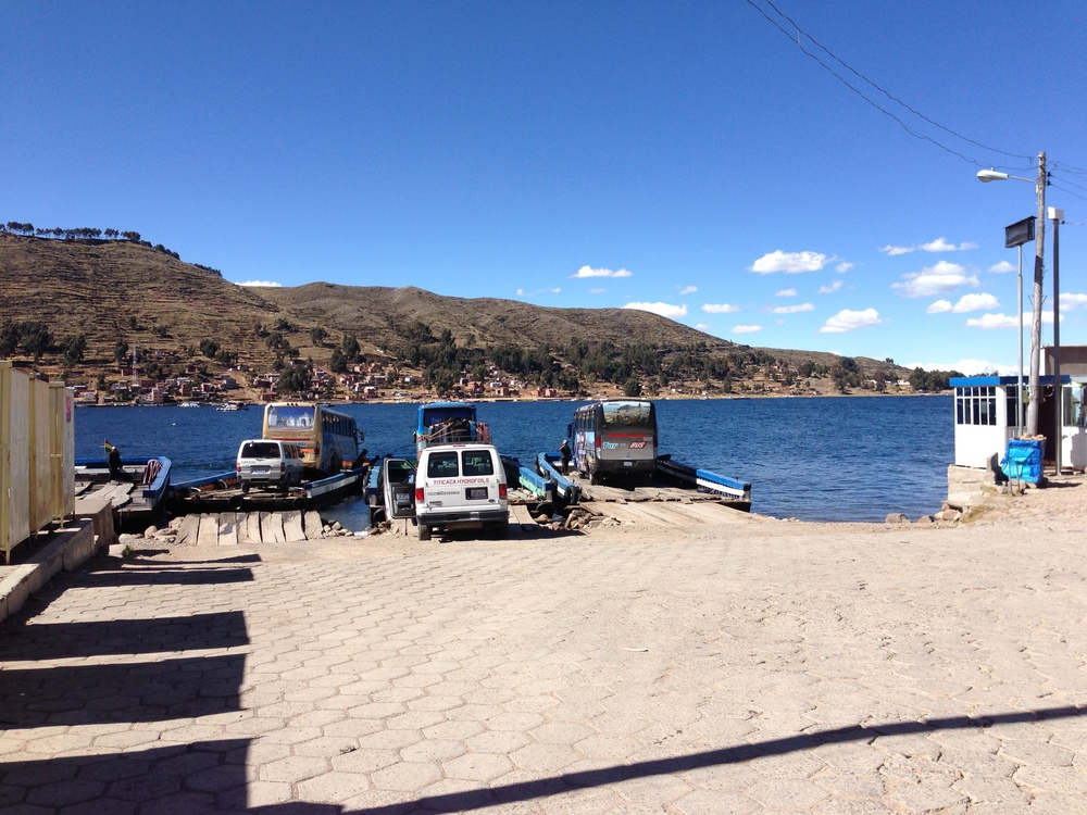 Our bus being loaded onto our barge. This was from my bus trip between Copacabana and La Paz.