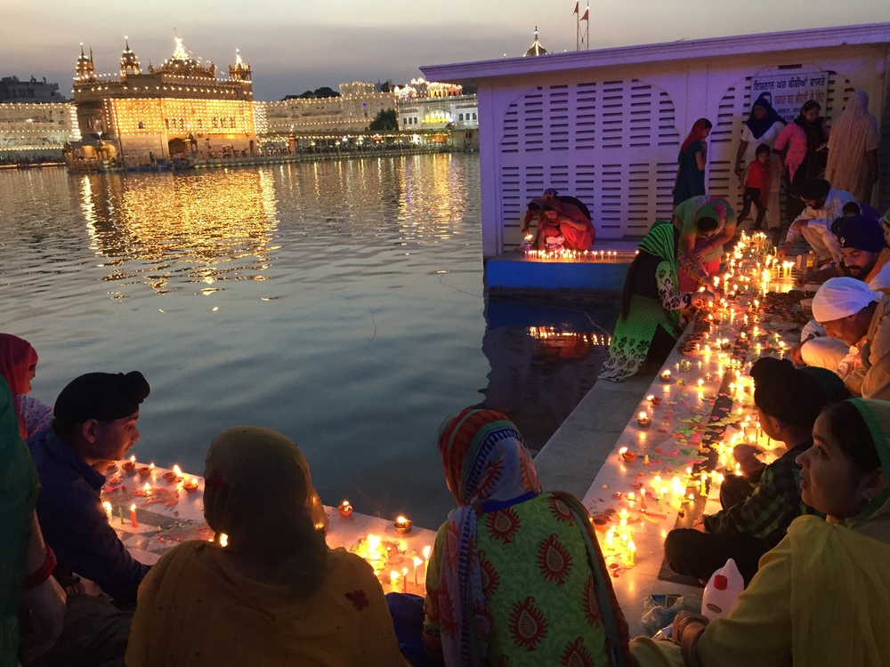 I was in Amritsar for Diwali, the Hindu Festival of Lights. The Sikhs here celebrate the return of their sixth guru, and have a slightly different festival on the same day. The Hindu festival celebrates the return of Rama.  There were candles all around the water.