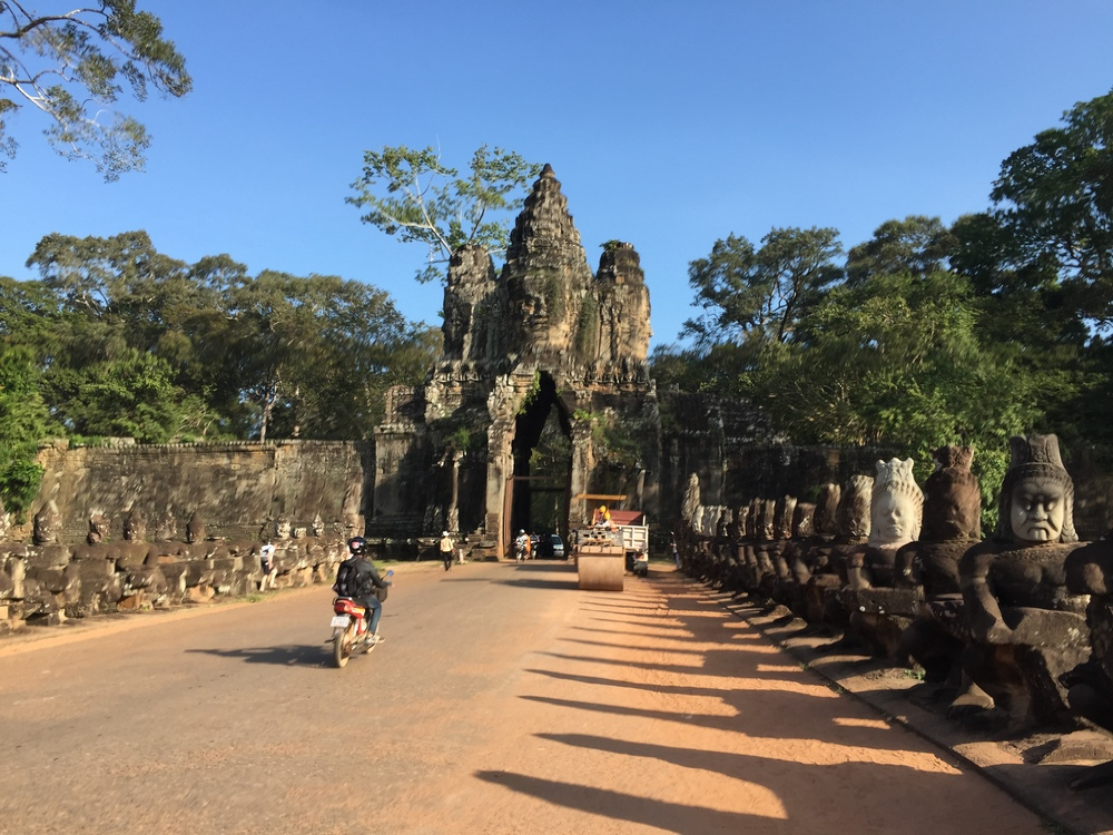 My first picture from Cambodia! I saw the prime minister of Cambodia at the border crossing, but my phone was dead so I couldn't snap his picture. This is taken at Angkor Thom, a temple near Angkor Wat. I actually studied this complex at Michigan in a Southeast Asia class I took, so getting to see it was very meaningful. If you look closely, you can see the heads on the gate are facing in four directions, signifying the face's dominance of all four directions. If I remember correctly, my professor said that it's unclear exactly who the face is of, but his bet was that it was of a king who meshed his face with the face of the Buddha.