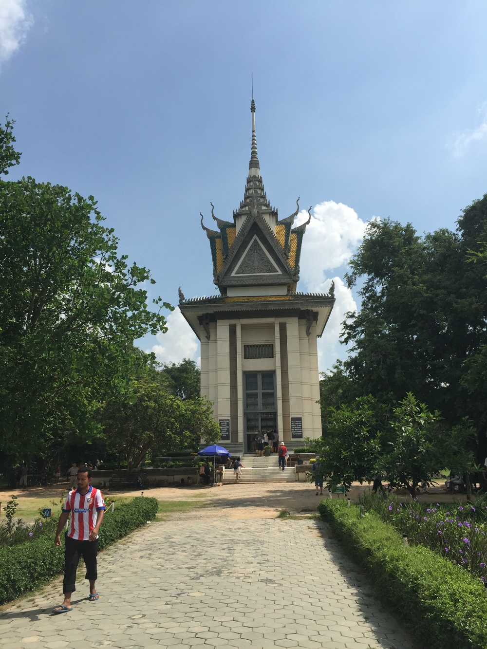 This is a place called Choueng Ek, where Pol Pot's regime murdered thousands of people. They hung loud speakers from the trees so that they could drown out the screams. Very upsetting place.