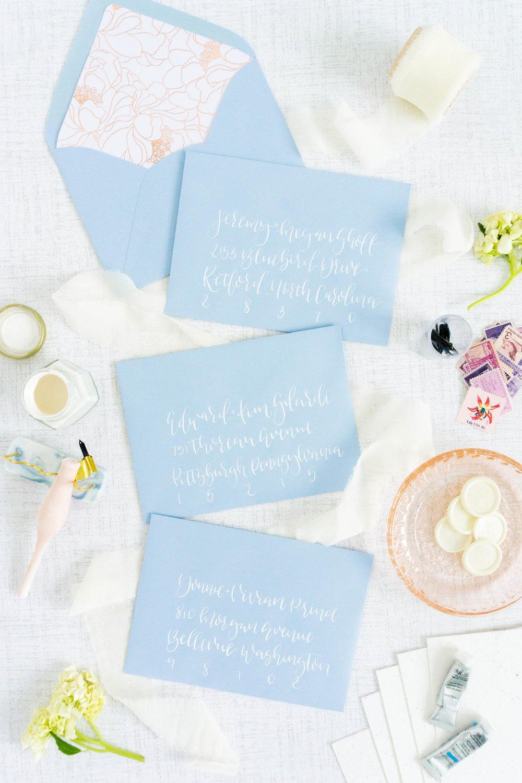 love-fern-design-studio-custom-wedding-invitations-for-the-modern-couple-modern-calligraphy-in-seattle-washington-custom-wedding-stationery-light-blue-white-envelopes
