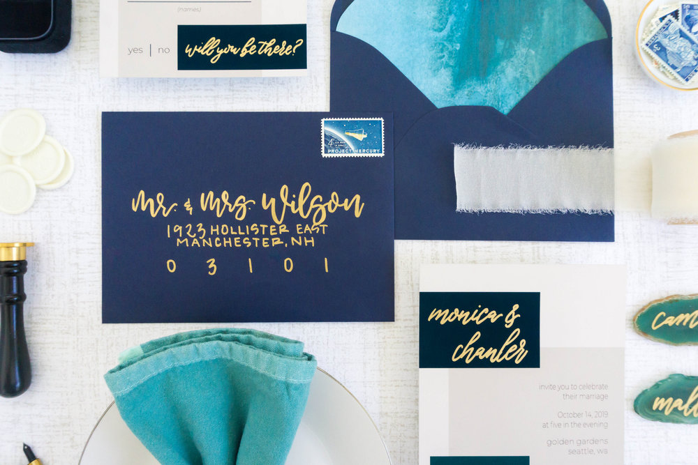 love-fern-design-studio-custom-wedding-invitations-for-the-modern-couple-modern-calligraphy-in-seattle-washington-custom-wedding-stationery-navy-gold-teal-modern-color-block-invitation-envelopes
