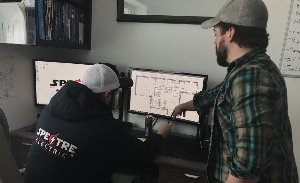 Brannon going over plans with his electrician, charlie siegfried of spectre electric