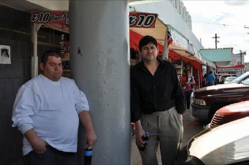 Reynaldo Hernandez (left) and Eduardo Ruiz stand outside a bus station after spending the night there. The men were deported from Illinois to Matamoros, Tamaulipas, Mexico. Photo by María Inés Zamudio.
