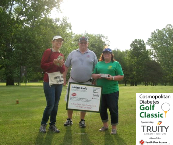 Golfers having fun at the Cosmopolitan Golf Tournament in Lawrence, Kansas.