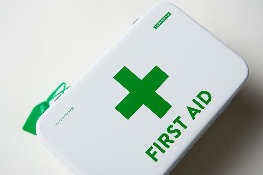"Especially made for this mailing, the Premium First Aid Kit contains everything you need to treat a minor injury at home – bandages, gauze, compresses, eye patches, cold patches, tape, antibiotic cream, CPR mask, plastic gloves, and a safety flag. Best of all, the Kit comes in a durable, organized, and well-labeled 5"" x 8"" metal carrying case. The design on the case is even compliant with international standards so most everyone should be able to identify what is contained inside during an emergency."