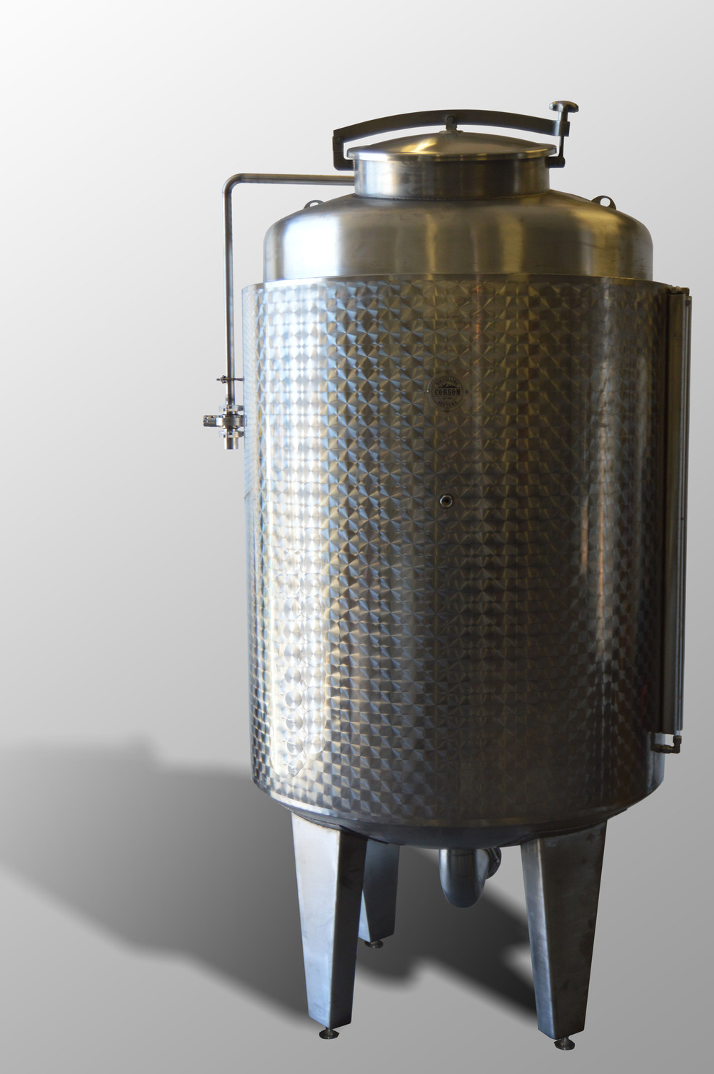 Stainless distillery fermenter with dished bottom.