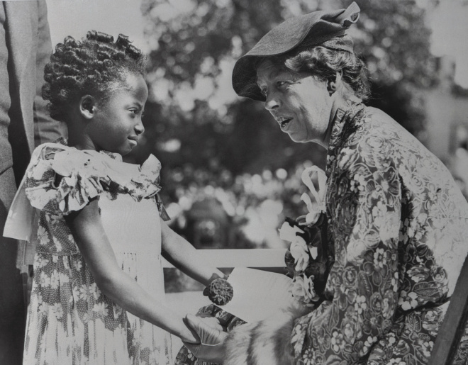 First Lady Eleanor Roosevelt speaking with a child in 1935 (Photo:   CORBIS)