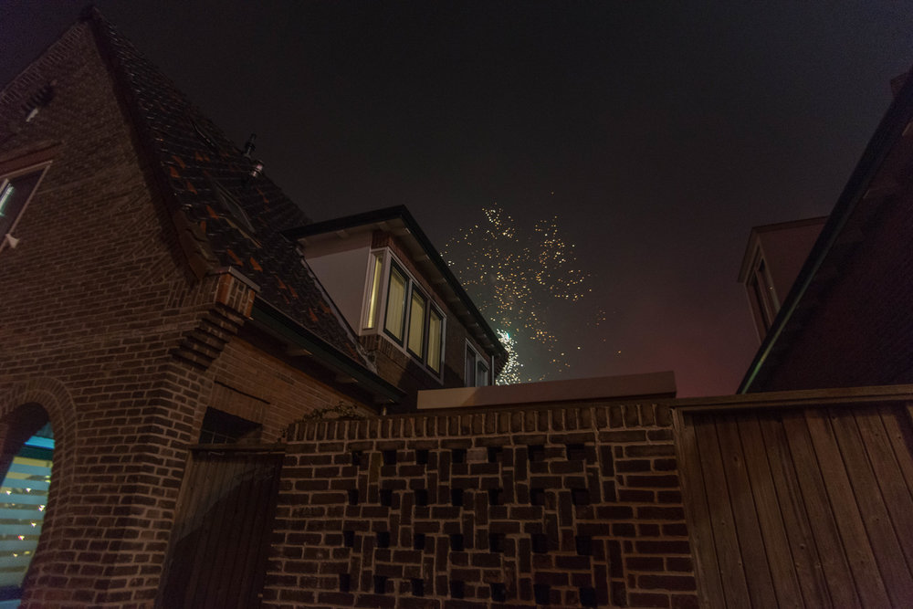 the fireworks light up my oma's house on new year's