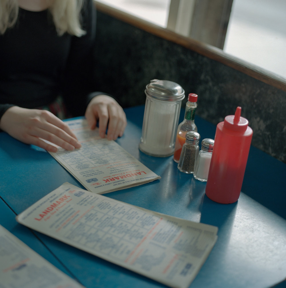 Emma's hands at yet another diner. can't get enough of em (taken on a Hasselblad)