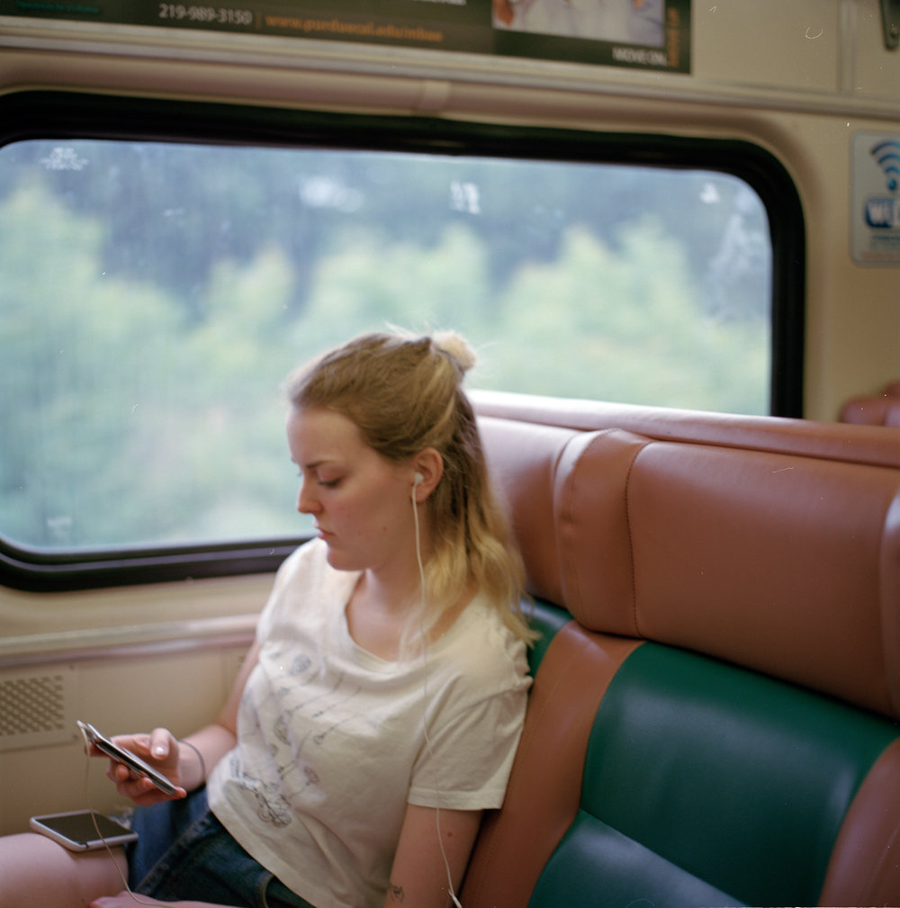 emma on the train to the dunes (shot on hasselblad)