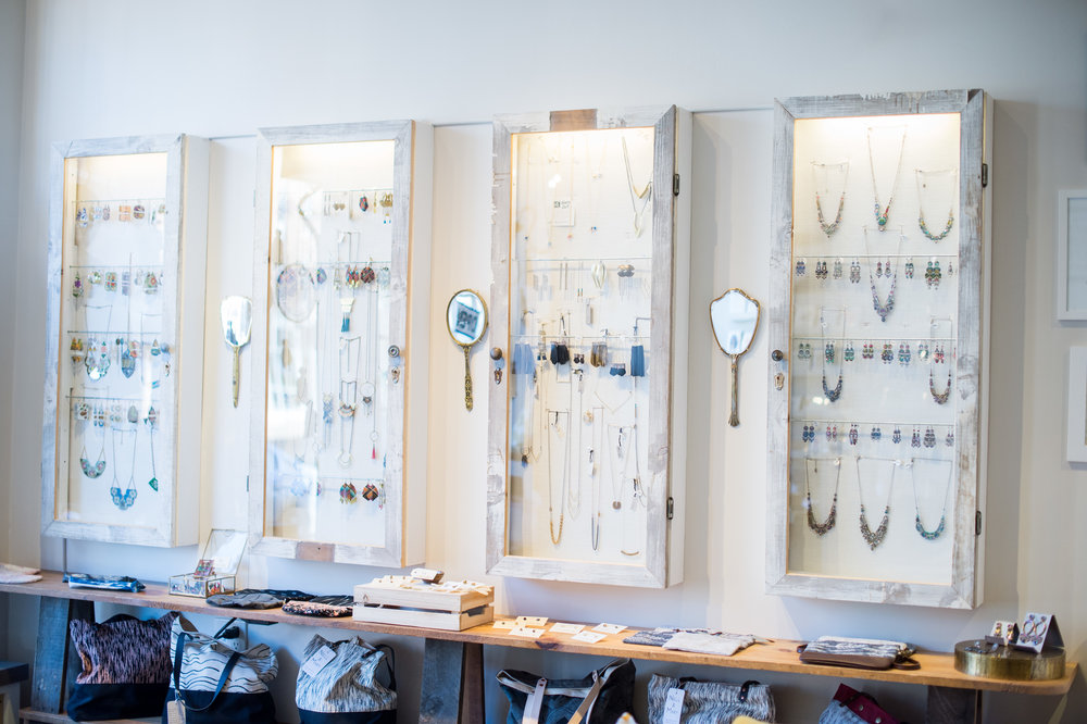 Custom jewelry cases with vintage hand mirrors to admire yourself.