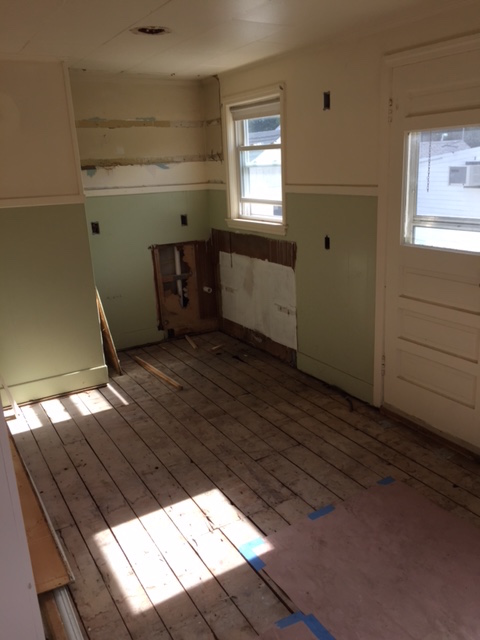 Guys.  This here kitchen was so darn scary before demo.  We were able to salvage most of the wall paneling and sheet rock, but the floors were brought right down to the original sub floor.