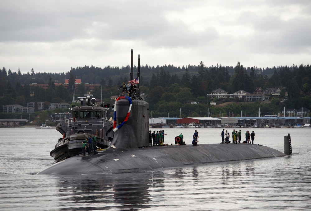 Sailors assigned to the Fast-Attack submarine USS Seawolf (SSN 21) return home to Naval Base Kitsap-Bremerton.