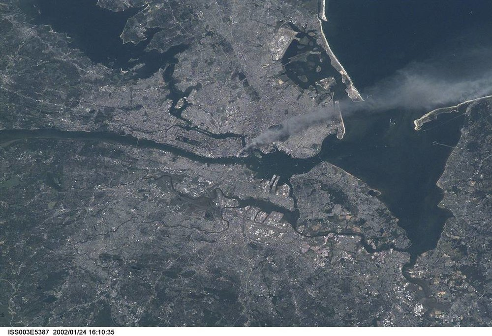 Photograph Credit: Frank Culbertson, Astronaut and Station Commander, United States National Aeronautics and Space Administration - On Board the International Space Station, 2001/09/11 - World Trade Center from the International Space Station.