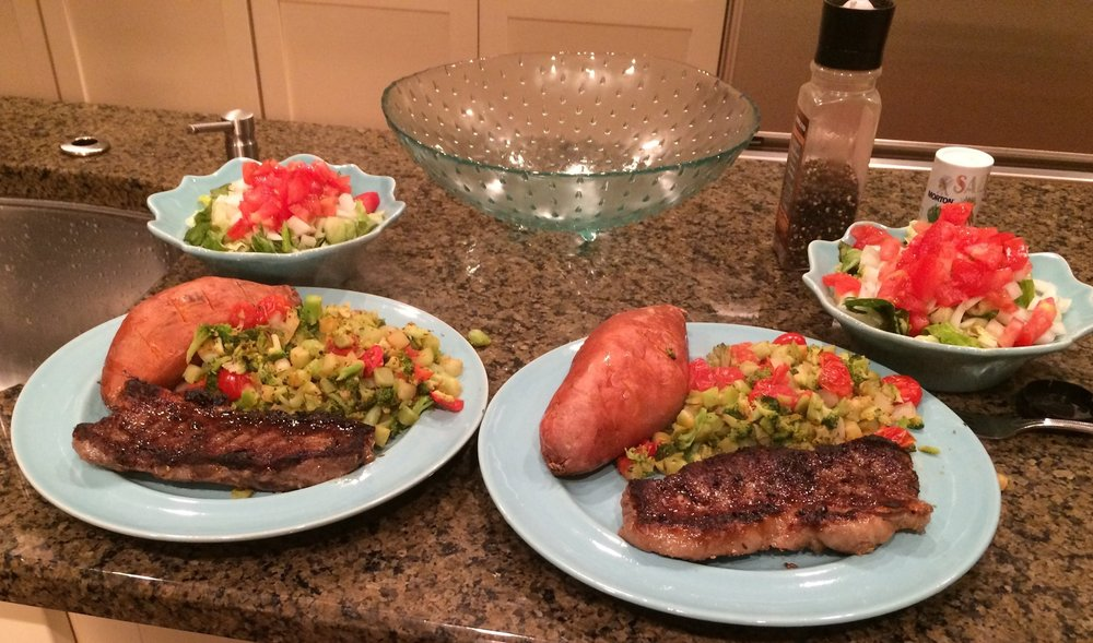 Exhibiting our self-proclaimed gourmet chef skills on Night #2: NY Strip, Sweet Potato, Vegetable Medley, & Starter Salad