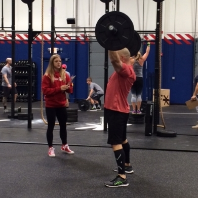 Chelsey Hughes judging an athlete from CrossFit TreeHouse