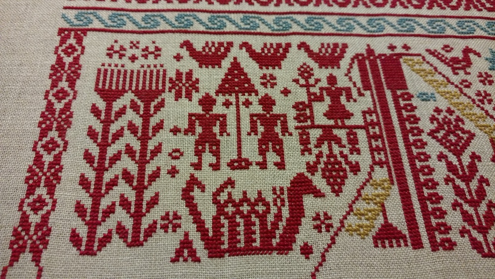 Motifs and border on the left side.
