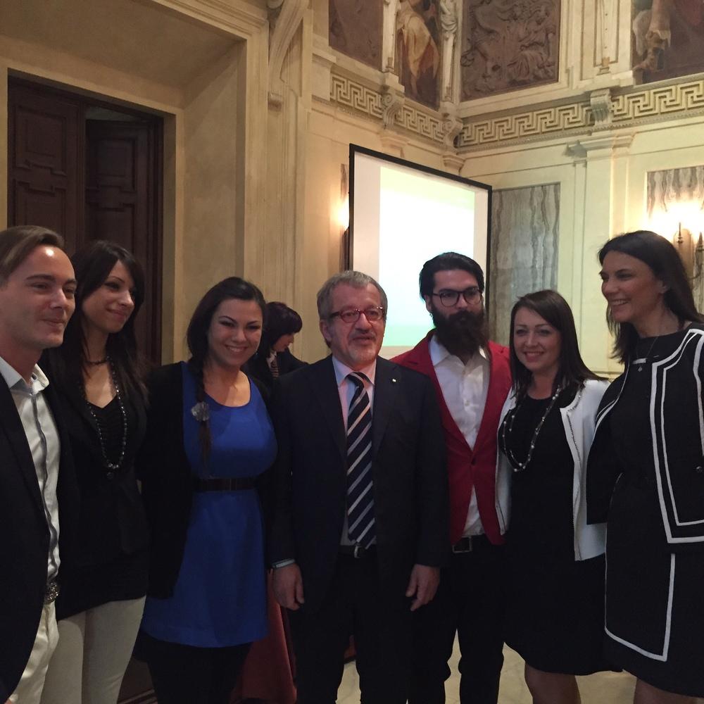 Milano, Palazzo Marino -Il Presidente di Regione Lombardia Roberto Maroni, si congratula con gli studenti finalisti della Ferrari Fashion School e in particolare con la vincitrice Alice Carminati.