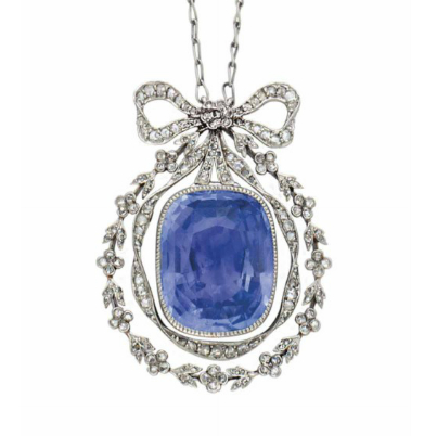 A sapphire and diamond pendant in the garland style of the Belle Epoque, featuring a small Sevigné bow motif circa 1905. For sale in the April 14th Magnificent Jewels Auction at Christie's New York . (photo courtesy of Christie's)