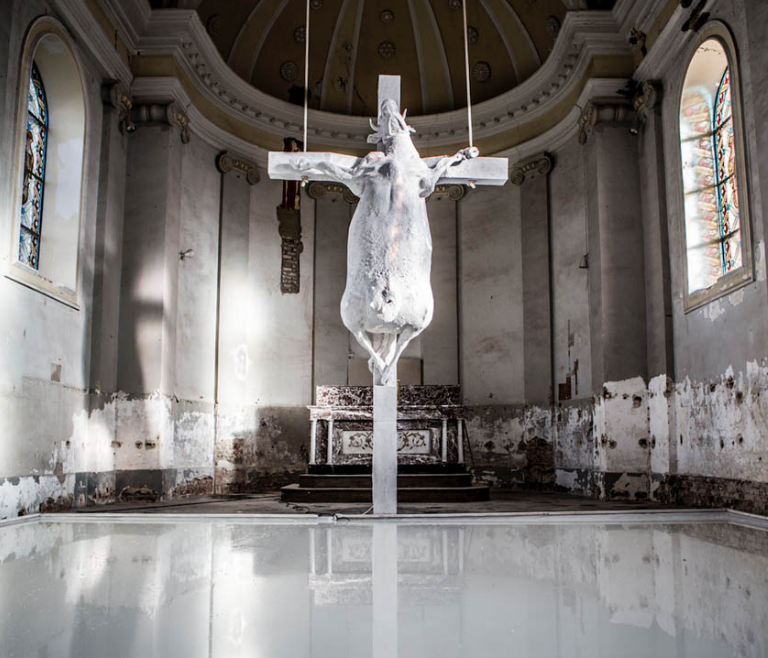 HOLY COW / 2017   Holy Cow is an autonomous project of the artist Tom Herck. It is an overwhelming piece of art, exhibited in the church of Kuttekoven, Belgium. It is not a coincidence that Tom Herck created this piece of art at the age of 33, which was the age of Jesus being crucified.On the floor there is a giant tub (81 square metres) containing 5000 litres of water mixed with powder and milk…    Read more