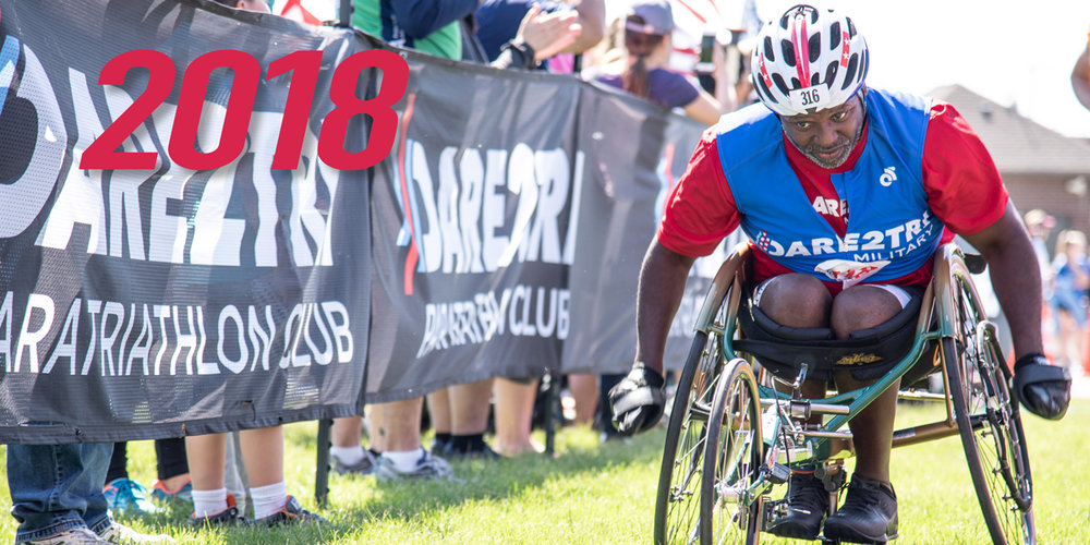 Dare2tri 2018 Impact Report. Althete in racing chair coming down the finish line shoot at Leon's Triathlon.