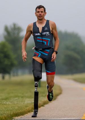 Athlete Adam Popp runs in a Dare2tri kit.