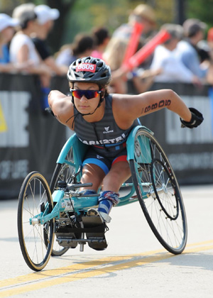 Athlete Ahalya Lettenberger competing in her racing chair.