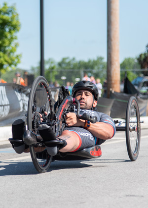 Athlete Howie Sanborn riding a hand cycle, racing at Leon's Triathlon.