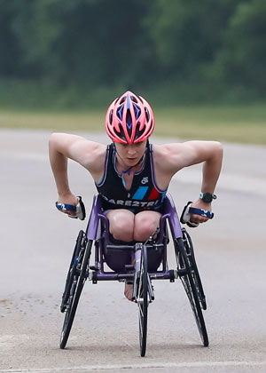 Kendall Gretsch in a racing chair wearing a Dare2tri kit.